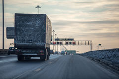 Truck on dirty winter ring road in the evening Stock Photography