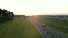 Truck Driver Carrying Cargo On Highway At Sunset Background Aerial View