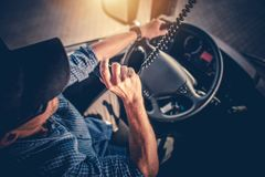 Truck Driver CB Radio Talk. Semi Truck Driver Making Conversation with Other Truck Drivers Through CB Radio stock photography