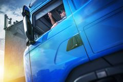 Truck Driver Contract. Young Caucasian Men in His 30s Inside His Brand New Blue Semi Truck stock images