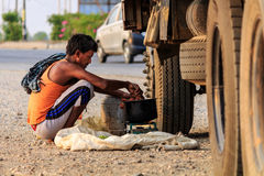 A truck driver is cooking food for breakfast beside national highway Stock Photo