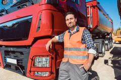 Truck driver in front of his freight forward lorry. Looking at camera royalty free stock photos