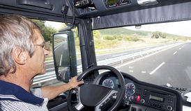 Truck Driver. On the highway stock photography