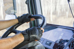 Truck driver keeps driving wheel with both hands Royalty Free Stock Images