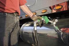 Truck driver pumping gas Stock Photos