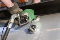 Truck driver pumping gas stock image