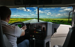 The truck driver on the road. Among fields highway. business trip Stock Photos
