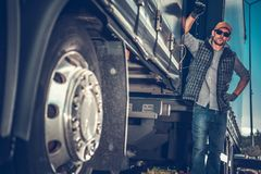 Truck Driver Between Trailers. Caucasian Truck Driver in His 30s Between Semi Trailers. Transportation and Logistics Theme stock image