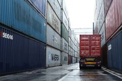 Truck driver wait to unload container on docks. Matosinhos harbour containers stacked on piles with truck on line to unload stock photos