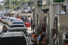 Truck drivers` strike. Rio de Janeiro, Brazil - may 25, 2018: Because of the truck drivers` strike the city faces lack of fuel. The drivers queue to fill the royalty free stock photography
