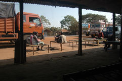 Truck drivers taking rest in India. Truck drivers relaxing at a roadside restaurant called 'dhaba' on the highway of India Royalty Free Stock Photography