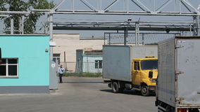 Truck drives to transport organization for receive cargo. Russia, Novosibirsk - July 25, 2015: Truck drives on the territory of the transport organization for stock video