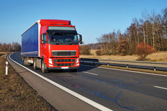 Truck driving along a highway in the countryside Royalty Free Stock Image