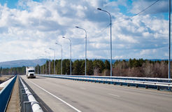 Truck driving on the bridge over the river Royalty Free Stock Photography