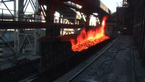 Truck driving through a burning coal. The process of working on the production of coke stock footage