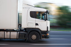 Truck driving on city street Stock Image