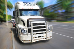 Truck driving on city street Royalty Free Stock Images