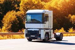Truck is driving on the country highway Stock Photos