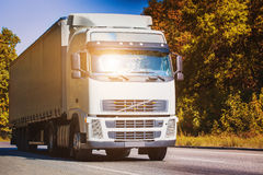 Truck is driving on the country highway. White truck is driving on the country highway Royalty Free Stock Photo