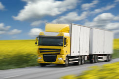 Truck driving on country-road. Motion blur Stock Images