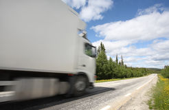 Truck driving on country-road. /motion blur Royalty Free Stock Images