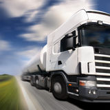 Truck driving on country-road/. Motion blur Stock Photography