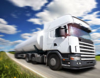 Truck driving on country-road/. Motion Royalty Free Stock Image