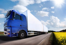 Truck driving on country-road/. Motion Stock Photography