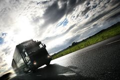 Truck driving on country-road/. Motion Stock Photos
