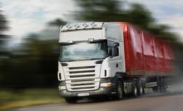 Truck driving on country-road/. Motion Stock Image