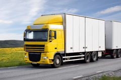 Truck driving on country-road. Photo of truck driving on country-road Royalty Free Stock Image