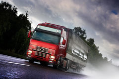 Truck driving on country-road. Photo of a truck driving on country-road Royalty Free Stock Photos
