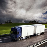 Truck driving on country-road. Photo of a truck driving on country-road Stock Photos