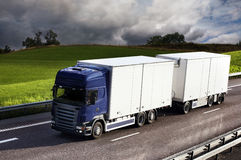Truck driving on country-road. Photo of truck driving on country-road Stock Photo