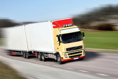 Truck driving on country-road/motion. Photo of truck driving on country-road/motion Royalty Free Stock Image