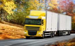 Truck driving on country-road/motion. Photo of a truck driving on country-road/motion Royalty Free Stock Photo