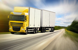 Truck driving on country-road. Photo of a truck driving on country-road Royalty Free Stock Photo