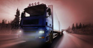 Truck driving on country-road. /photographic-retouching Royalty Free Stock Photo