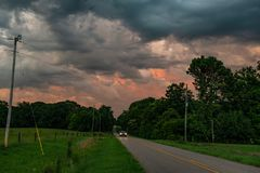 Truck driving on country road at twilight royalty free stock photo
