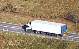 Truck driving on country road Stock Images