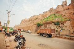 Truck driving on dirt road near historical Jaisalmer fort built in 1156 AD Royalty Free Stock Photos