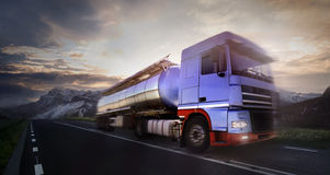 Truck driving at dusk/motion blur Stock Photos