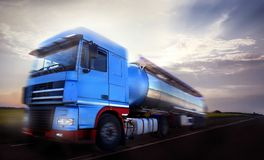 Truck driving at dusk/motion blur Stock Images