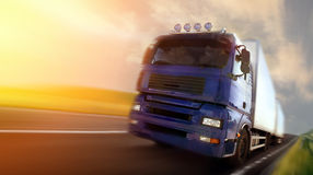 Truck driving at dusk/motion blur. Photo of truck driving at dusk/motion blur Stock Photography