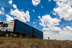 A truck driving on a flat road in the Free State, South Africa. Royalty Free Stock Images