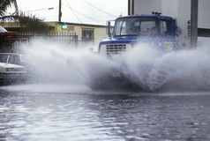 Truck Driving Through Flooded Street Stock Photos