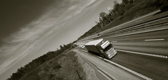 Truck driving on freeway Royalty Free Stock Images