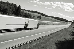 Truck driving on highway Stock Images