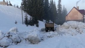 Truck driving on a mountain road in the woods in the snow. The action in real time stock video