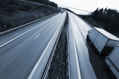 Truck Driving On Freeway At Dusk Stock Images